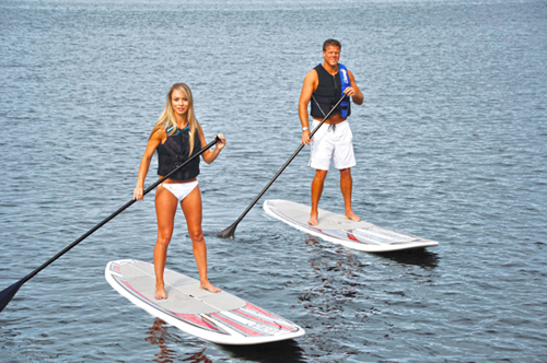 An woman and a man on paddle board